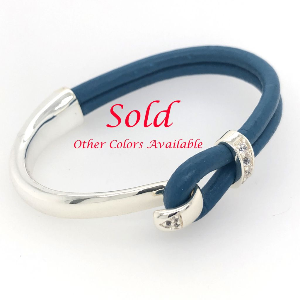 "Image Description of ""Cobalt Blue Round Portuguese Leather with Sterling Plated Bar Cuff Bracelet""."