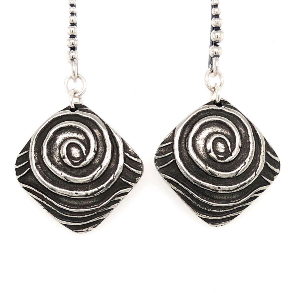 "Image Description of ""Dorabeth Drop Diamond Swirl Earrings""."