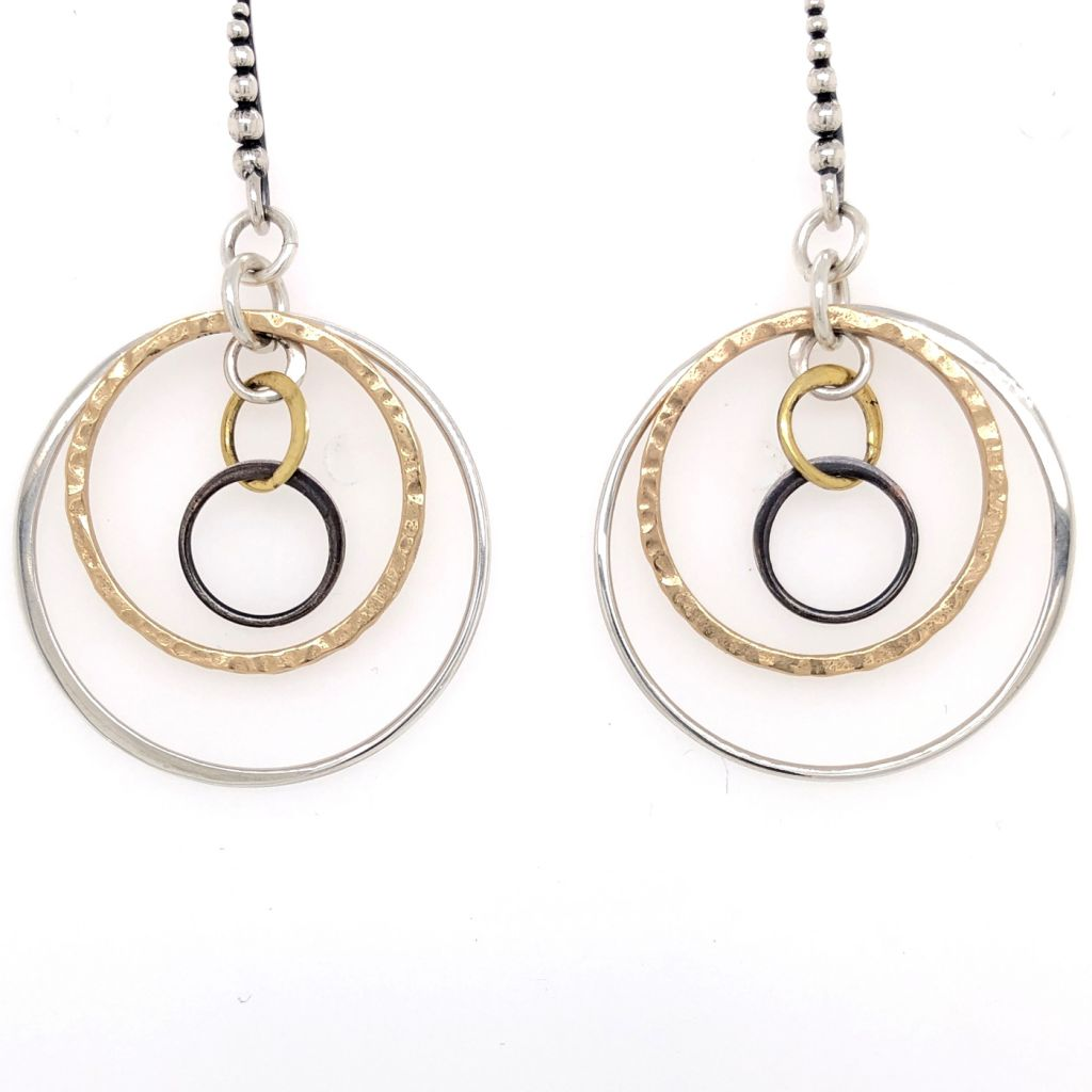 "Image Description of ""Graduated Circles Mixed Metals Earrings""."