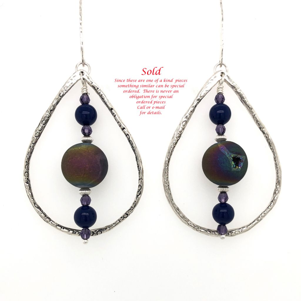 "Image Description of ""Sterling Silver Teardrop Earrings with Rainbow Druzy Agate Drops""."