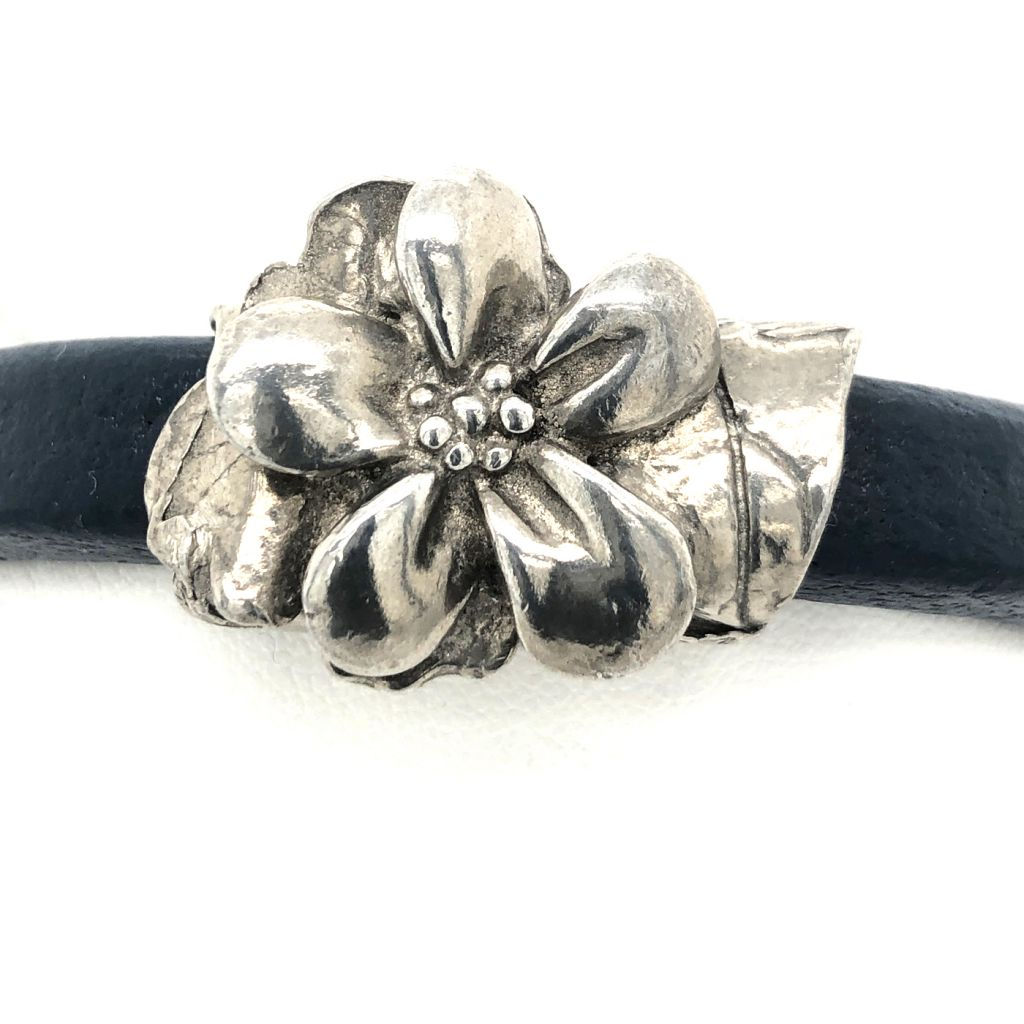 "Image Description of ""Blue Regaliz™ Leather with Dorabeth Designs Pewter Flower Bracelet""."