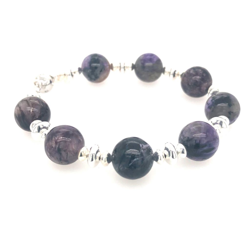 "Image Description of ""Charoite Rounds with Silver Accents Bracelet""."