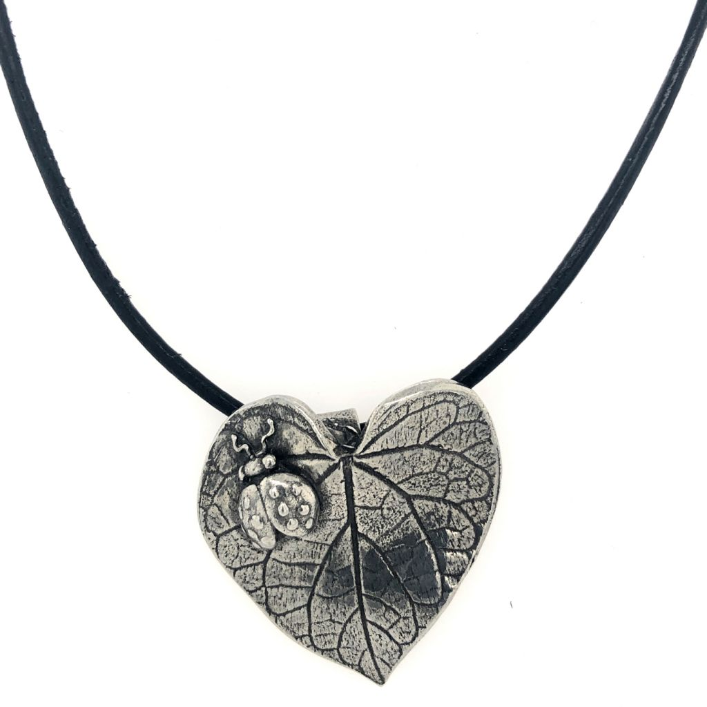 "Image Description of ""Dorabeth Designs Pewter Leaf with Ladybug on Leather Cord Necklace""."