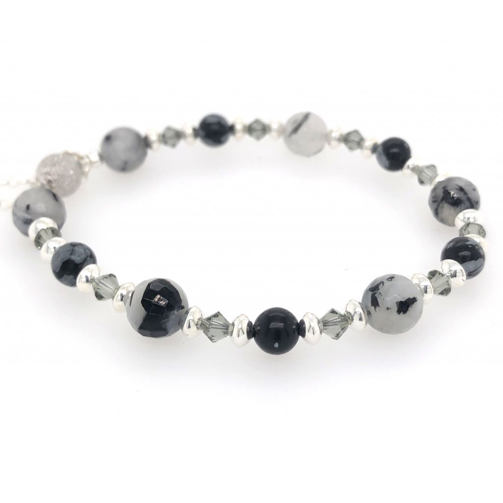 "Image Description of ""Faceted Black Tourmalinated Quartz & Snowflake Obsidian Rounds Bracelet""."