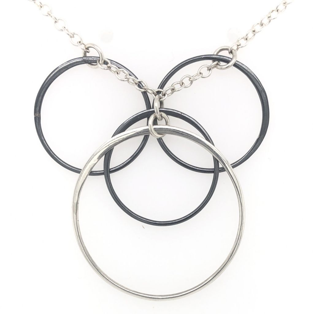 "Image Description of ""Black Oxidized & Sterling Silver Multi Circles Necklace""."
