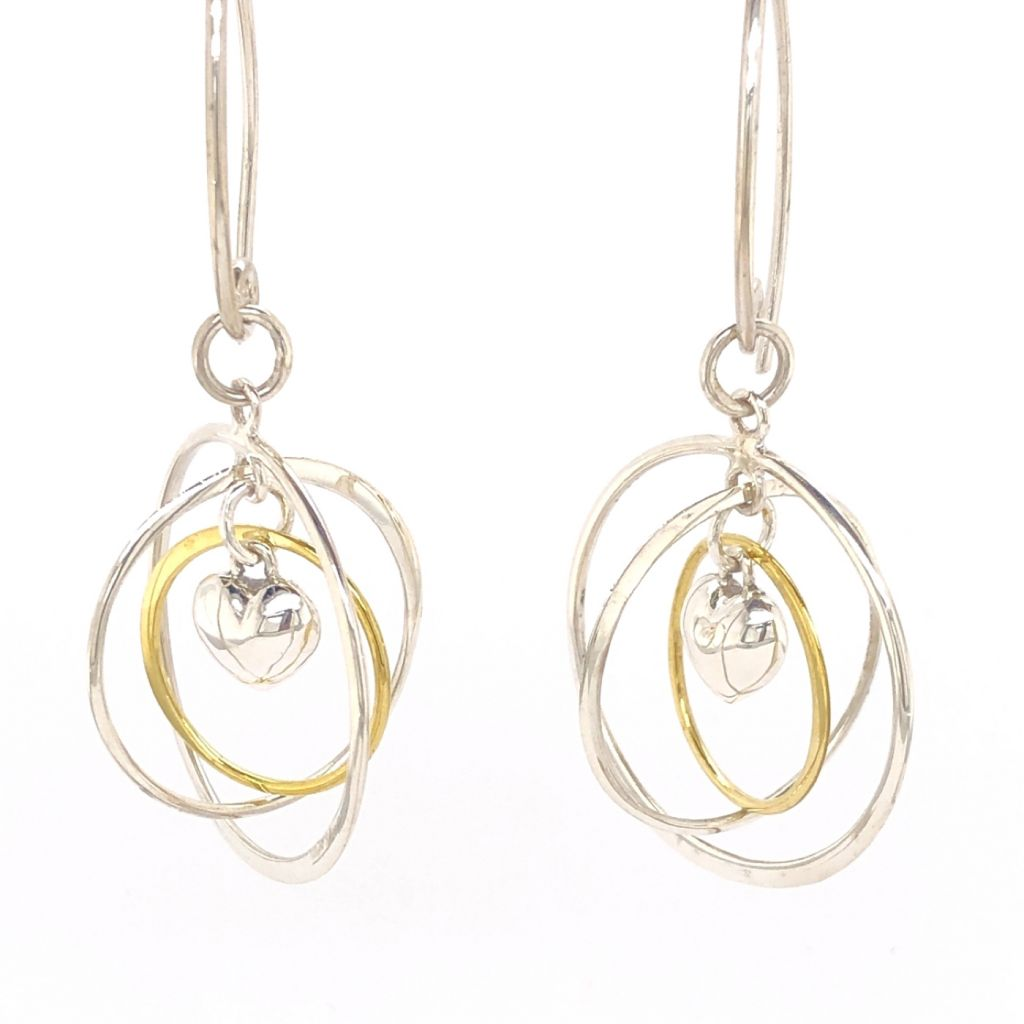 "Image Description of ""Sterling Silver & Gold Puffed Heart Gyroscope Earrings""."