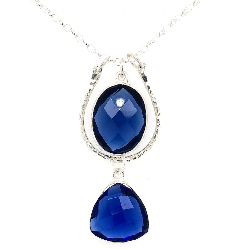 "Image Description of ""Sterling Silver Hammered Horseshoe-Shaped Link with Dark Blue Gemstones Necklace""."